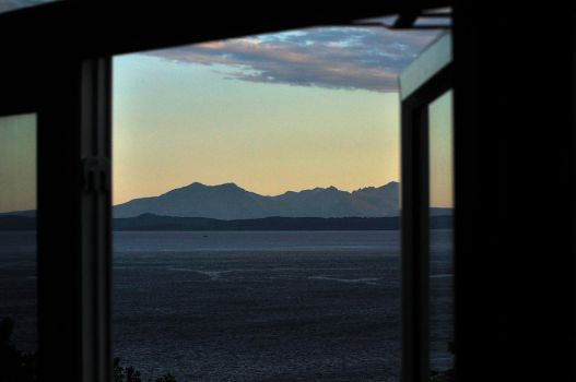 Arran (Scotland) from our dining table at sun set by Dr-Koesters
