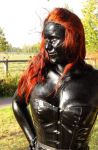 Redhead in black shiny bodypaint oil by chrischaaan