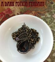 A Dark Potion Pendant by tanyquil