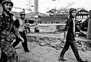 workers in a street of Chengdu by clalepa