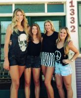 Tall volleyball player with friends by lowerrider