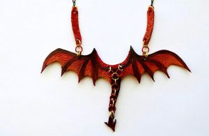 Single Wing Fiery Dragon Necklace Close-Up by mandokyramud
