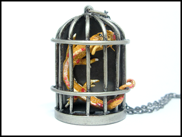 Golden Dragon in a Cage Necklace by GrandmaThunderpants