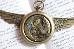 Close up of Steampunk Golden Winged Watch Necklace by tgwttn