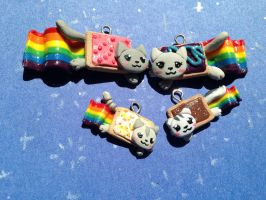 Nyan Cat's Growing Family by TheFreckledLeaf
