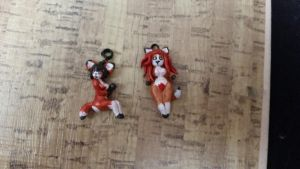 foxy gals pendanrs by RoxyHasHorns