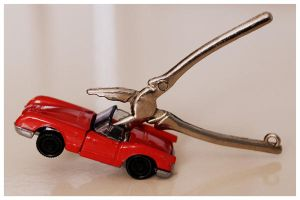tweezers and a car by Maleiva