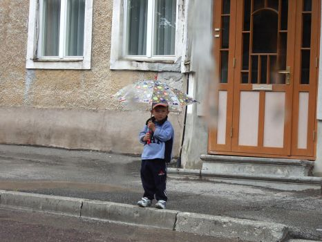 A boy with umbrella... by Jokahr