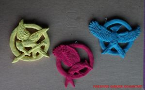 The Hunger Games necklaces by MrOsOG3