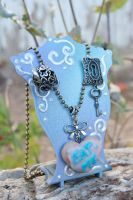 Wonderland Eat Me Cookie Necklace by IvrinielsArtNCosplay