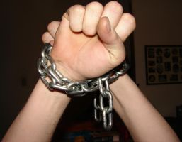 Grey Male Hands Chained 03 by FantasyStock