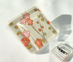 Blossoms on peach brooch by inchworm