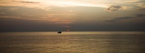 Boat in a sunset by devoidofanchovies