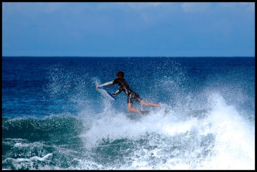 Jumping over Banzai Pipeline by rx7