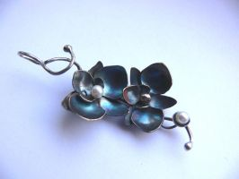 Patinated orchid pendant by irineja