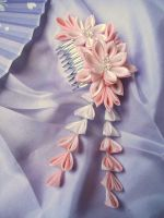 Pink and white dahlia on comb by elblack
