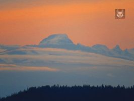 Snowcapped Orange Sunset Mountain by wolfwings1