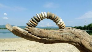 Driftwood hand and stone arch in hungary by kanya by tom-tom1969