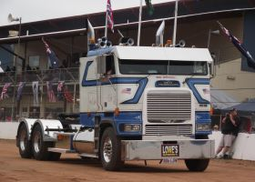 White Frieghtliner cabover on parade by RedtailFox