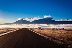 Spanish Peaks Over Fog by dkwynia