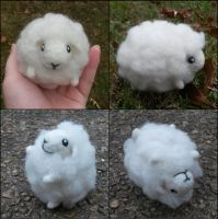 Fluffy felted sheep by SnowFox102