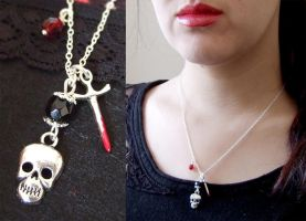 skull and bloody knife necklace by yael360