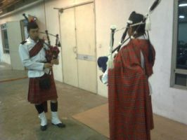 blowing the bagpipes by MadBoxx