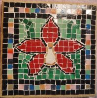 Red orchid glass tile mosaic on a cement paver by Amazinadrielle