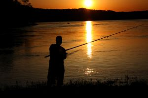 Silhouetted Fisherman by bigpaganjames