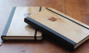 Autobot and Decepticon Plywood Moleskines by cornertone