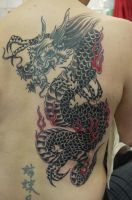 cover up gragon by ubertattooist