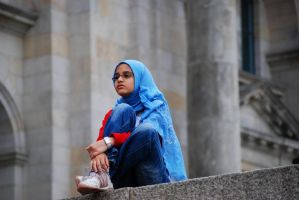Girl sitting on a wall by aamira-ji