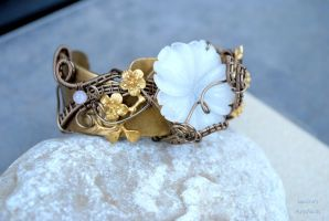 White jade flower wire wrapped cuff by IanirasArtifacts