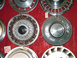 junk yard - hubcaps by JensStockCollection