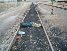 Boy on Train Tracks by Falln-Stock