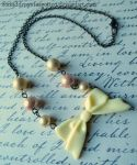 Vintage Bow Necklace by Forbiddenynforgotten