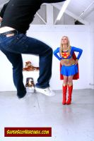 Supergirl blowing guy by Superbreath