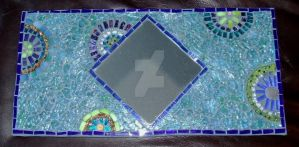 1st  tempered glass mirror. by Manicmosaics