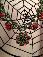 Woven beads with a web by Arachnoid