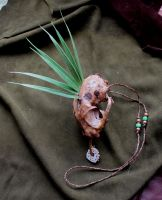Painted bobcat skull necklace by lupagreenwolf