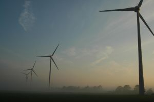Row of windmills in the fog by BlokkStox