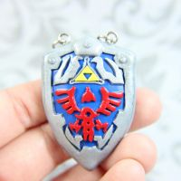 Legend of Zelda Hylian shield necklace by TrenoNights