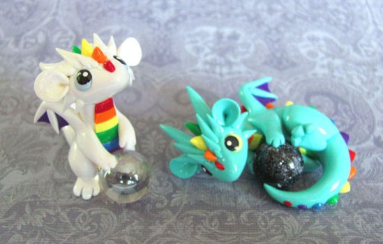 A couple rainbow babies by DragonsAndBeasties