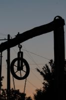 Well - detail on wheel at sunset by ddmkro
