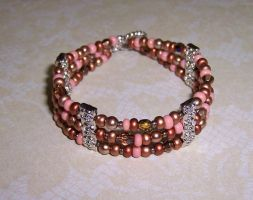 Pink and bronze cuff by asukouenn
