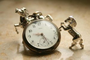 broken pocket watch with miniature horses by Nexu4