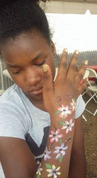 flower face paint by funfacesballoon