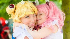 Sailor Moon and Chibi Moon cuddle by ElspethDark