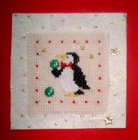 Penguin playing with christmas balls by Vetriz