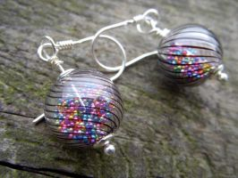 Hollow glass candy earrings by kickthebucket